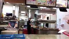 Motion of worker making hamburger for customer inside Burger king Stock Footage