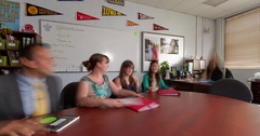 Moving Time-Lapse of teacher meeting in a classroom Stock Footage