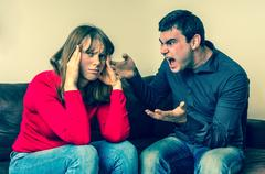 Young couple into an argument in living room Stock Photos