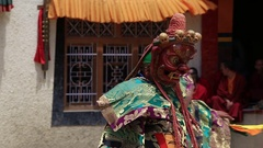 Tibetan men dressed in mystical mask dancing in Buddhist festival, Ladakh, India Stock Footage