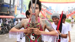 Man walks with his mouth pierced in Vegetarian Festival at Phuket Town. Thailand Stock Footage