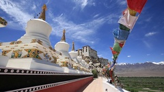 Buddhist prayer flags and tibetan Stupa at Thiksey monastery. Leh, Ladakh, India Stock Footage