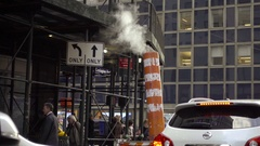 Orange steam pipe emitting smoke - steaming in Midtown Manhattan NYC Stock Footage