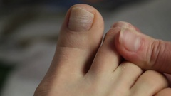 Woman getting pedicure in nail salon Stock Footage