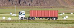 Truck driving through a rural area Kuvituskuvat