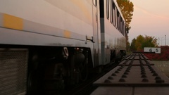 Train leaves frame showing empty tracks with fall weather background Stock Footage