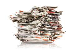 Pile of old folding newspapers isolated on white Stock Photos