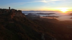 Civita di Bagnoregio in Italy, aerial view at dawn above the clouds Stock Footage
