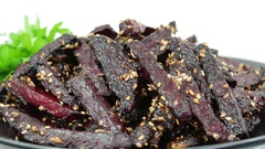 Healthy homemade roasted beetroot ready to eat in  plate . Rotates roasted beet Stock Footage