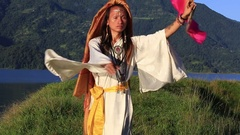 Shemale Sirena Sabiha dancing with a fan at sunrise in Pokhara, Nepal Stock Footage