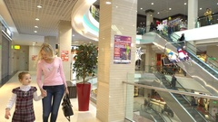 Mother and daughter shoping, walking at mall Stock Footage