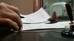 Close-up of a man in a bank signs a contract. Stock Footage