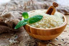 Bowl with long grain rice and fresh mint. Stock Photos