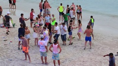 Girls and guys dancing the beach during Full Moon party. Koh Phangan. Thailand Stock Footage