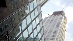 Chrysler Building upward angle street view close up skyscraper Manhattan NYC Stock Footage