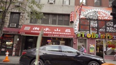 Driving past Two Boots Pizza pizzeria and flatbed truck in Midtown Manhattan NYC Stock Footage