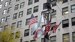 American flags on intersection street corner with one way arrow signs NYC Stock Footage