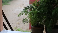 Flooding and tropical rain on the street in island Koh Phangan, Thailand Stock Footage