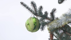 Toy ball spruce winter hanging on the christmas tree christmas new year Stock Footage