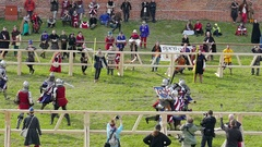 Team of medieval knights from Lithuania fight with knights from United States Stock Footage