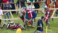 Team of medieval knights from Denmark fight with knights from France Stock Footage