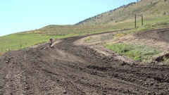 A young man riding a motocross dirt bike. Stock Footage