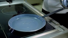 Pour oil into a frying pan Stock Footage