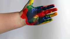 Children's hand in the paint Stock Footage