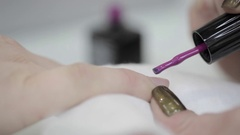 The procedure of painting nails in the baeuty salon. Stock Footage