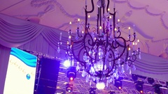 Decorative chandelier hanging on the ceiling in the Banquet hall Stock Footage