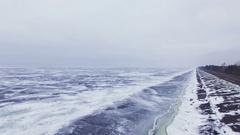 4K Aerial. Winter road near  frozen sea or lake. Kingdom of winter Stock Footage
