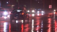 Rainy night and car traffic on the city streets of Toronto Stock Footage