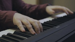 Guy playing on an electronic piano Stock Footage