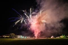 Bright fireworks plenty smoke Stock Photos