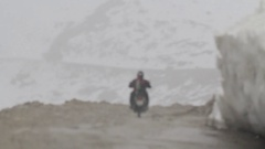 Driving in the snow fall at Himalayas Stock Footage