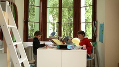 Kids doing homework in their room Young boys playing in their room Stock Footage