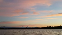 Sunset with reflection in river Kamchatka Stock Footage