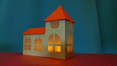 Cardboard church with flickering flame inside Stock Footage