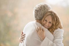 Portrait smiling affectionate couple hugging Stock Photos