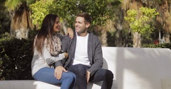 Affectionate young couple enjoying a quiet chat Stock Footage