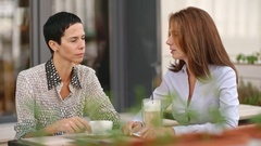 Women Meeting in the Street Cafe Stock Footage