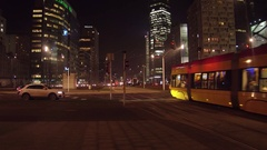 WARSAW, POLAND - DECEMBER, 22, 2016. Modern trams and night traffic at busy Stock Footage