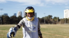Portrait of a young man playing lacrosse, slow motion. Stock Footage