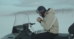 Young programmer who using notebook on snowmobile in adverse winter conditions Stock Footage