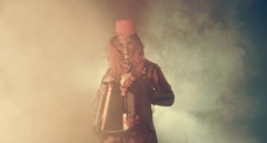 Venetian fancy accordion player in the smoke and darkness. Masquerade. Stock Footage