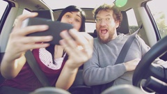 Happy people taking selfie while driving car Stock Footage
