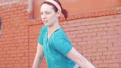 A couple working out and stretching together in an urban environment, slow motio Stock Footage