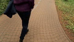 Girl the brunette one with the purple sweater and shirt walking on the track Stock Footage