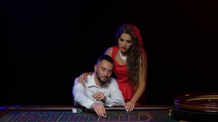 Winning the game of roulette. Young couple hit the jackpot Stock Footage
