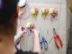 Florist at Work: Young Woman Making Boutonnieres of Different Flowers. Top View Stock Footage